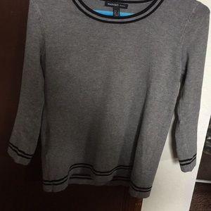A round neck grey sweater